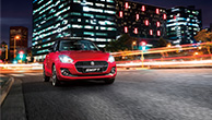 front-shot-of-red-Swift-running-in-night-city