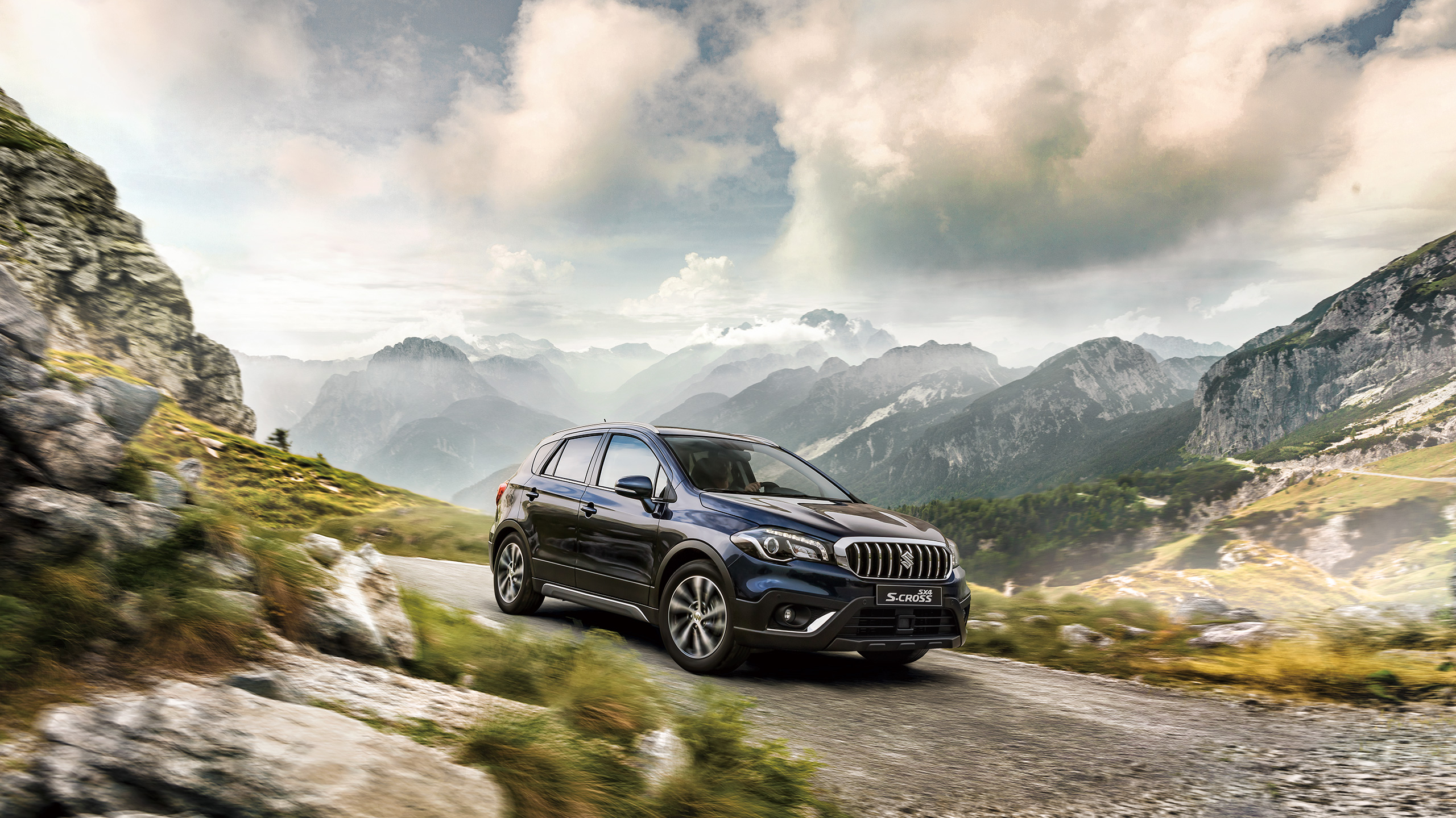 SX4-S-CROSS-driving-on-rough-road-in-mountains
