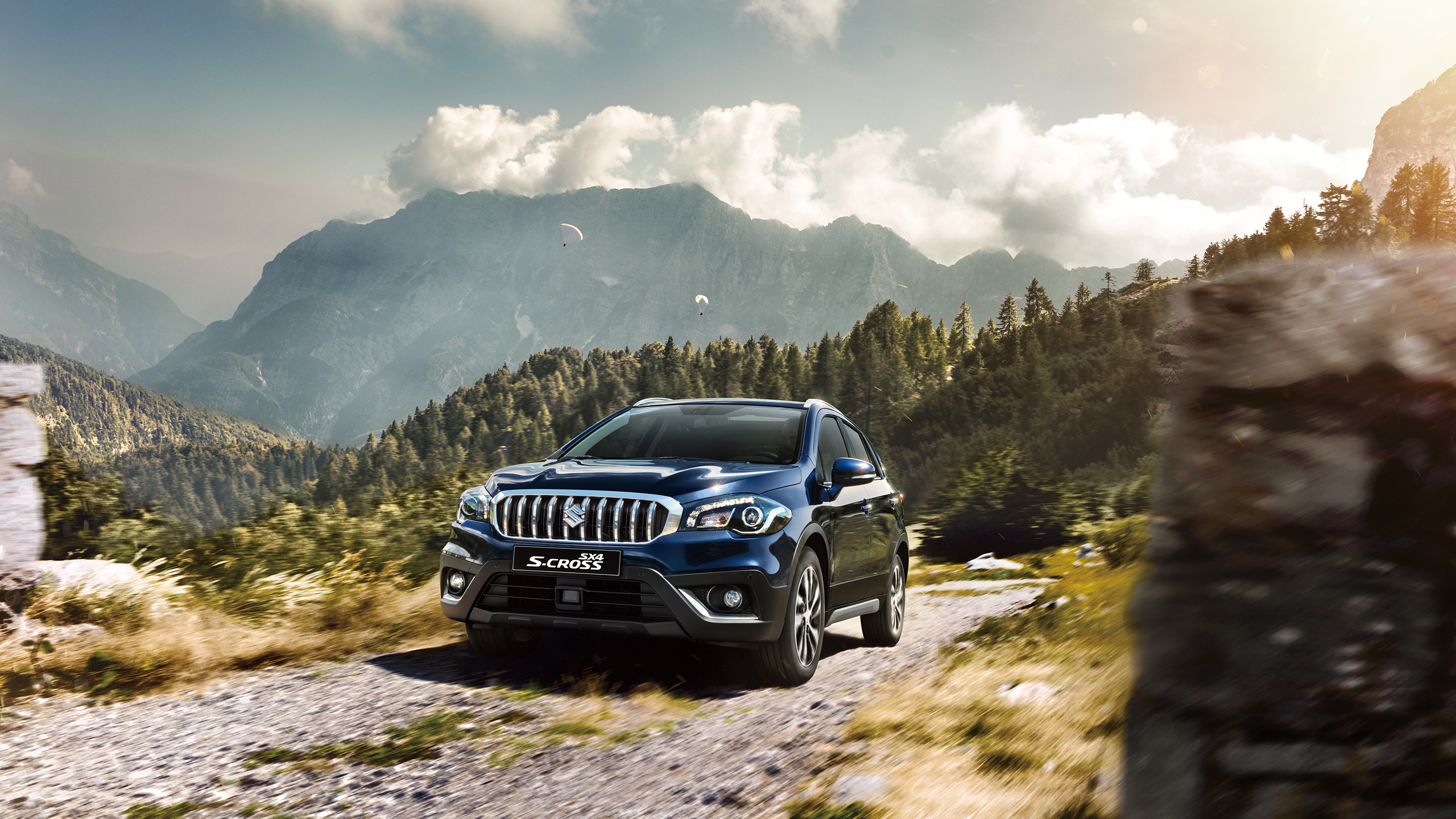 front-view-of- SX4-S-CROSS-driving-on-rough-road-in-mountain