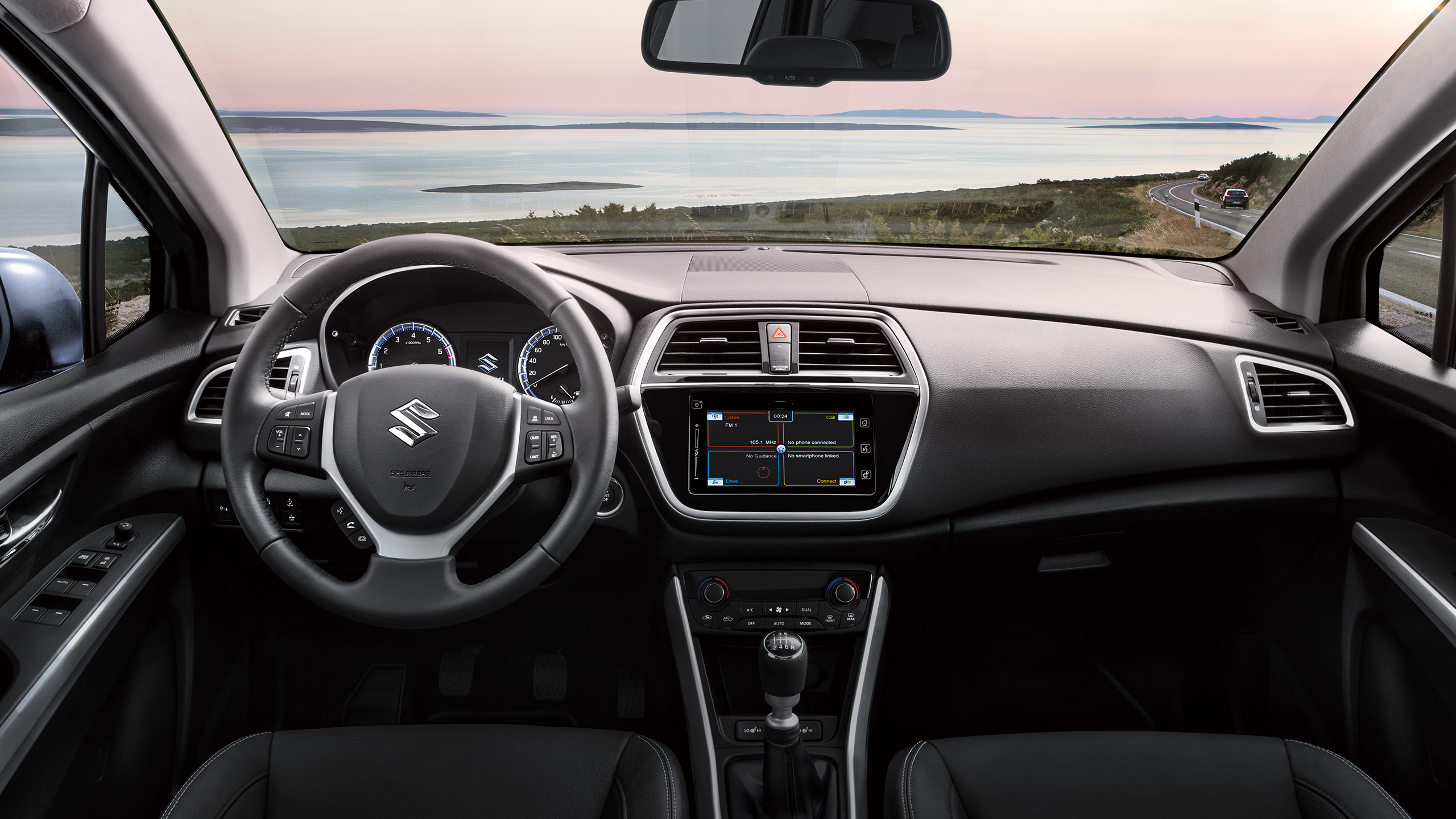 SX4-S-CROSS-interior-showing-instrument-panel-with-ocean-outside