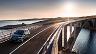 SX4-S-CROSS-driving-on-long-bridge-with-sunset